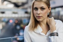 Portrait of blond woman looking at camera — Stock Photo
