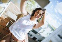 Woman taking selfie on balcony — Stock Photo