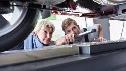 Car mechanic with client checking car — Stock Photo