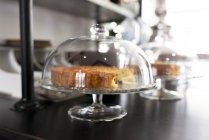 Cake on glass cake stand — Stock Photo