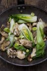 Stir-fry with chinese cabbage in pan — Stock Photo