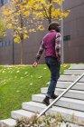 Man walking upstairs — Stock Photo