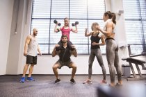 People doing fitness training in gym — Stock Photo