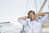 Man relaxing on sailing boat — Stock Photo