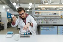 Technician taking samples in lab — Stock Photo