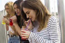 Friends drinking beverages outdoors — Stock Photo