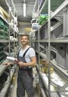 Man standing in warehouse — Stock Photo