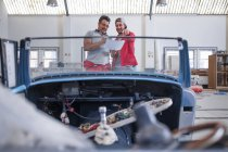 Mechanics restoring vintage cars — Stock Photo
