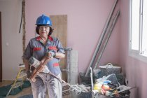 Woman with paint mixer at construction site — Stock Photo