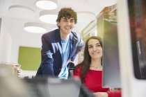 Man and woman working together in office — Stock Photo