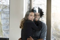 Couple hugging at home — Stock Photo