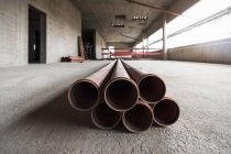 Pipes in unfinished building — Stock Photo