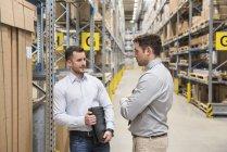 Men standing in factory — Stock Photo
