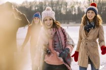 Happy friends outdoors in winter — Stock Photo