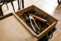 Wooden box with shoemaker tools — Stock Photo