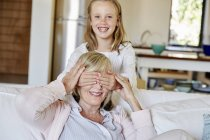 Girl having fun with grandmother — Stock Photo