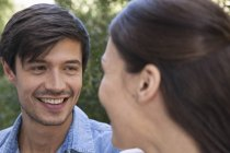 Young man smiling at girlfriend — Stock Photo