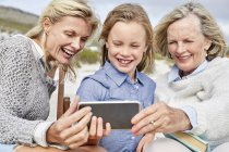 Mother with daughter and grandmother taking selfie — Stock Photo