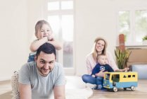 Portrait of happy young family at home — Stock Photo