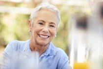 Portrait of smiling senior woman outdoors — Stock Photo