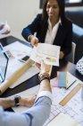 Handing document during meeting — Stock Photo