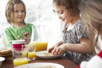Children at breakfast table — Stock Photo