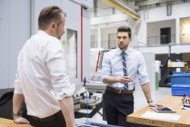 Businessmen discussing in factory — Stock Photo