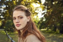 Woman with freckles in park — Stock Photo