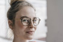 Young woman with glasses — Stock Photo
