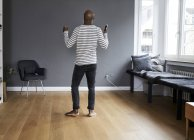 Mature man dancing alone at home — Stock Photo