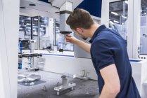 Man adjusting machine — Stock Photo