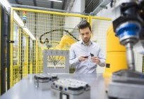 Businessman checking automated production — Stock Photo