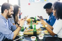 Friends using cell phones — Stock Photo
