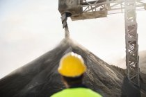 Worker wearing standing at quarry — Stock Photo