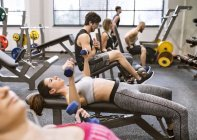 People exercising in gym — Stock Photo
