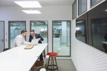 Businessmen using laptop office — Stock Photo
