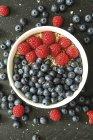 Granola with raspberries and blueberries — Stock Photo