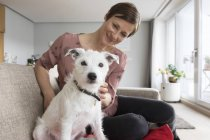 Woman and dog sitting together — Stock Photo