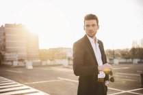 Businessman standing at parking level — Stock Photo