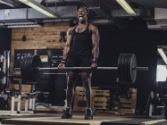 Athlete doing weight lifting — Stock Photo