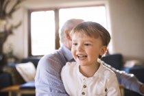 Grandfather and grandson having fun — Stock Photo