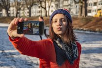 Ice skating woman taking selfie — Stock Photo