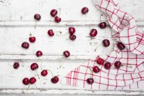 Cherries and kitchen towel — Stock Photo