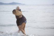 Women having fun in the sea — Stock Photo