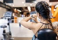 Woman using smartwatch in gym — Stock Photo