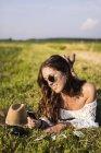Woman lying in summer field — Stock Photo