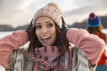 Woman holding woolly hat — Stock Photo