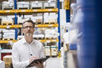 Man standing in storehouse — Stock Photo