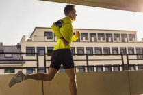 Man running on parking level — Stock Photo