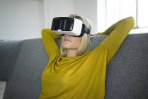 Woman wearing virtual reality glasses — Stock Photo